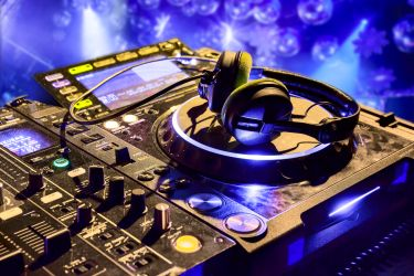 Dj-mixer-with-headphones-1