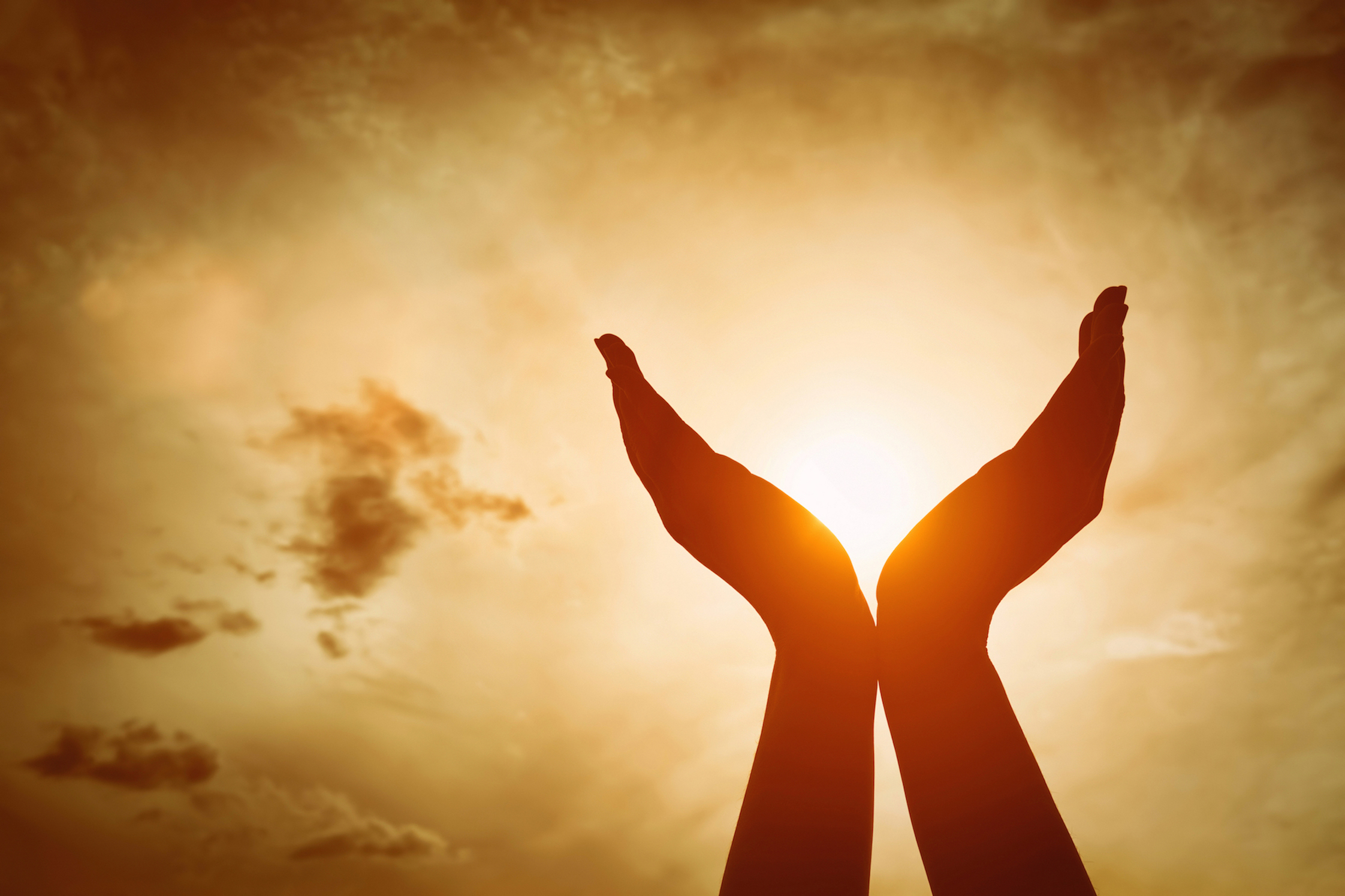 Raised hands catching sun shutterstock_432970087